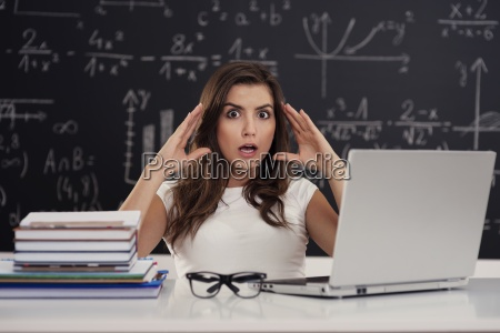 terrified young woman in classroom