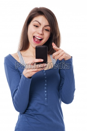 excitement woman with mobile phone pointing