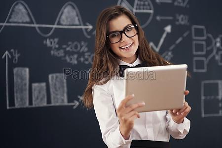 smiling, , teacher, using, digital, tablet - 12113728