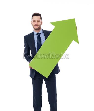 happy businessman with a green arrow