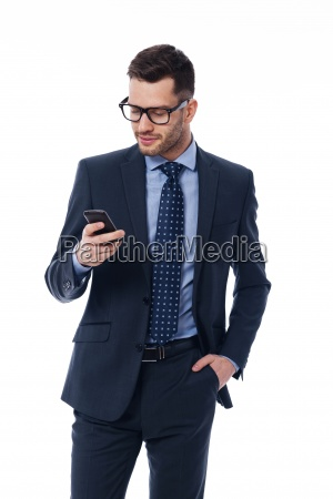 handsome businessman checking emails on the