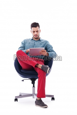 trendy and young man using digital