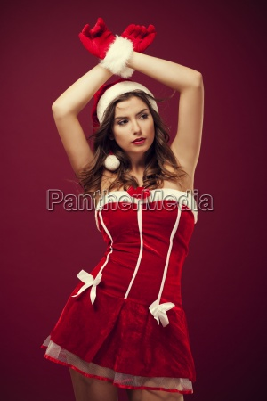 sexy woman wearing santa claus clothes
