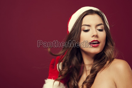 sexy santa claus on red background