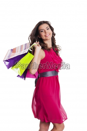 young beautiful shopper in the wind