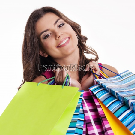 happy woman holding multi colored shopping