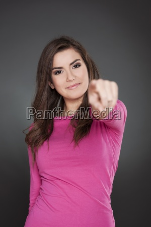 woman pointing at camera
