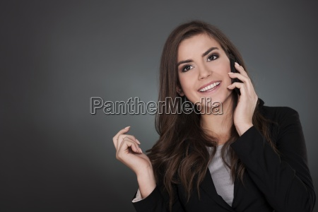 beautiful young woman talking on mobile