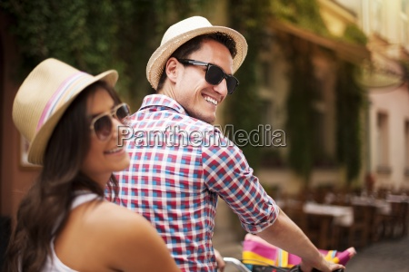 beautiful couple on bicycle in the