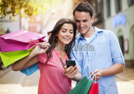 young couple with shopping bag using