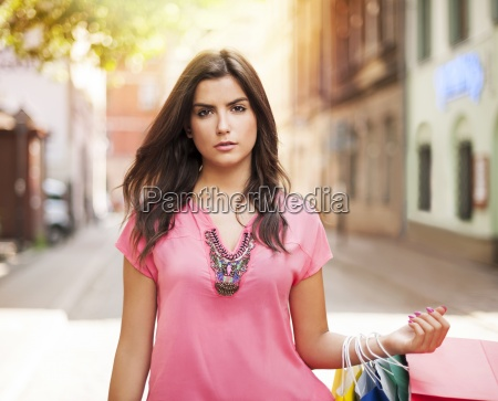 gorgeous woman with shopping bag on