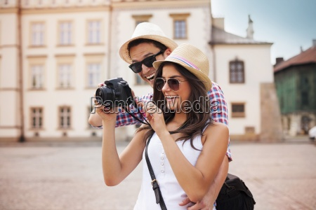 cute couple looking on their photos