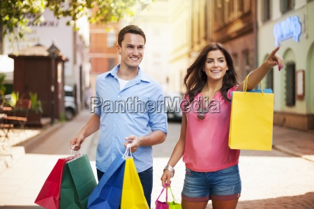 young couple with shopping bag in