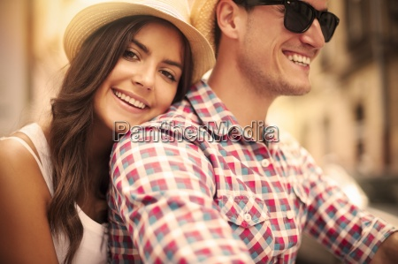 close up of loving couple riding