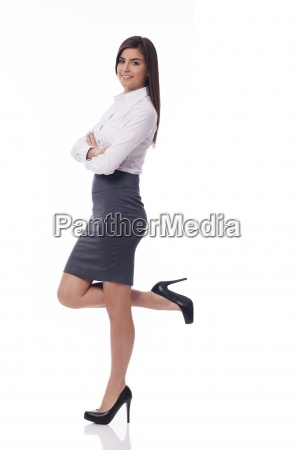 smiling businesswoman leaning on something