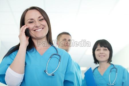 female surgeon talking on mobile phone
