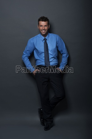 relaxed and confident businessman looking at