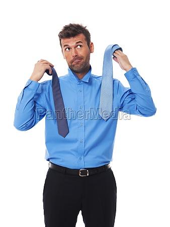 man wonders which tie to choose