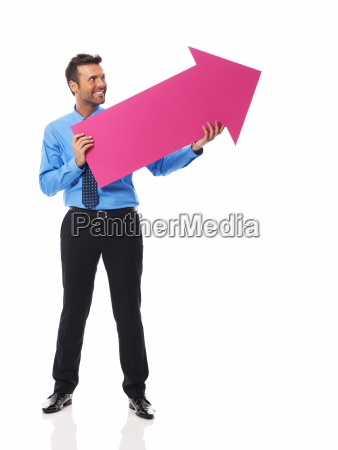 handsome business man holding pink arrow