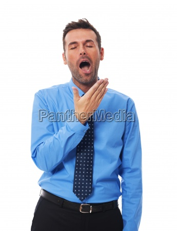 portrait of yawning handsome business man