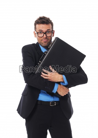 frightened man firmly clutching his briefcase