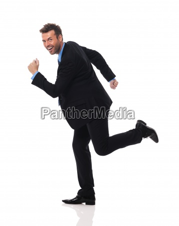 handsome and smiling businessman hurry up