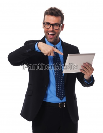 shocked businessman showing on digital tablet