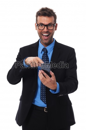 happy and surprised businessman pointing at