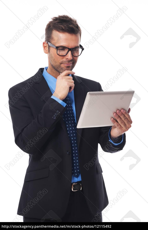 businessman, working, on, his, digital, tablet - 12115492