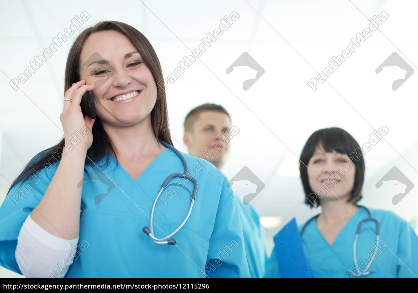 female, surgeon, talking, on, mobile, phone - 12115296