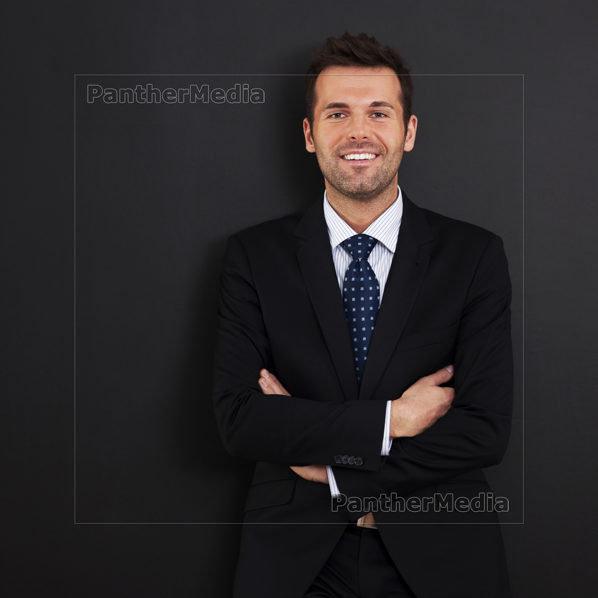 smiling, businessman, with, arms, crossed - 12115852