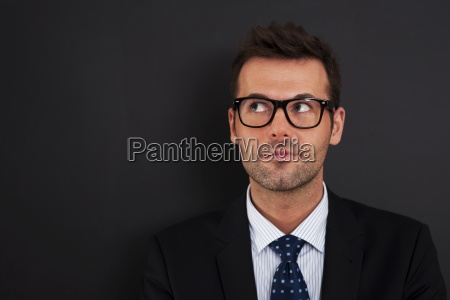 handsome businessman wearing glasses looking up