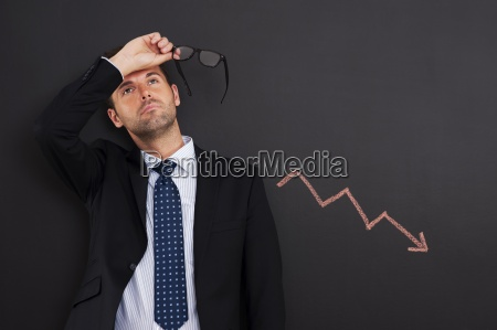 worried businessman with sign of decreased