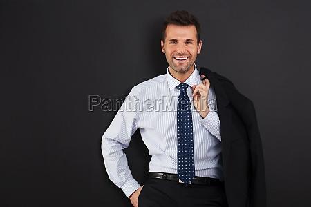 portrait of handsome smiling businessman