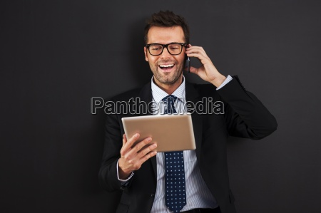 handsome businessman working with mobile phone