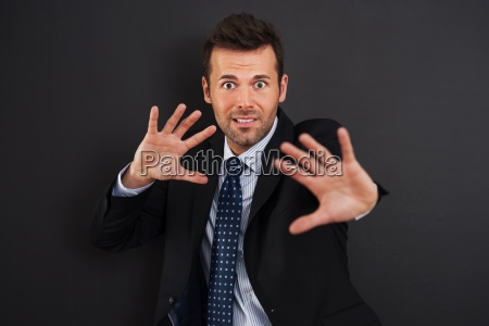 fearful businessman defending for something