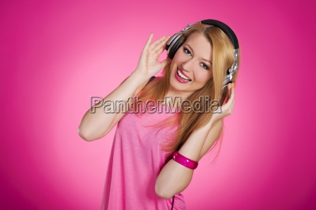 pink glamour woman listening to music