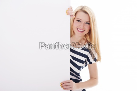 cheerful blonde woman pointing at blank