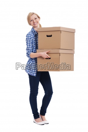 smiling woman carrying two boxes