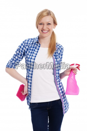 blonde female cleaner holding a sponge