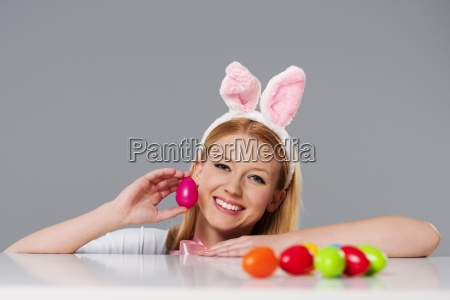 blonde woman with bunny ears and