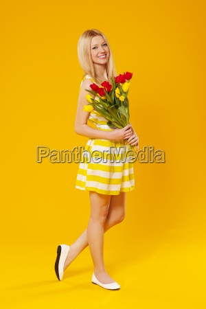 blonde woman holding bouquet of spring