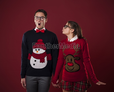 nerdy woman kissing shocked man