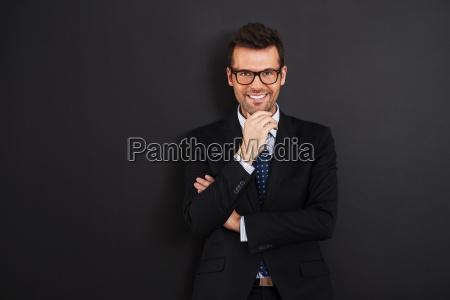 portrait, of, smiling, businessman, wearing, glasses - 12116128