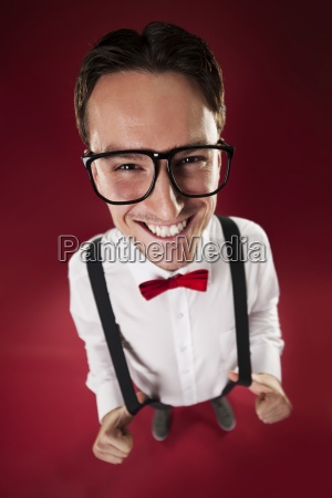 portrait of nerdy man wearing red
