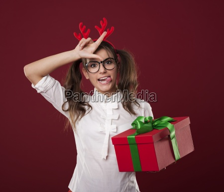 nerdy woman with christmas gift showing
