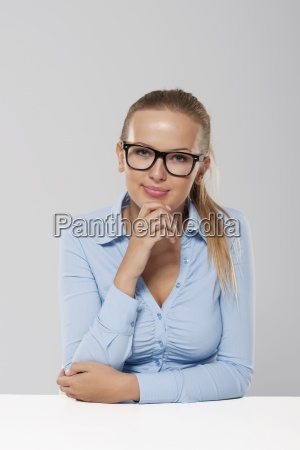 portrait of smiling blond businesswoman wearing