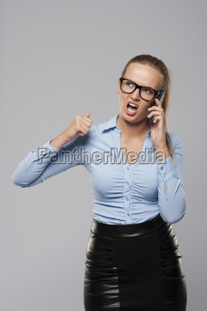 angry businesswoman shouting into the mobile