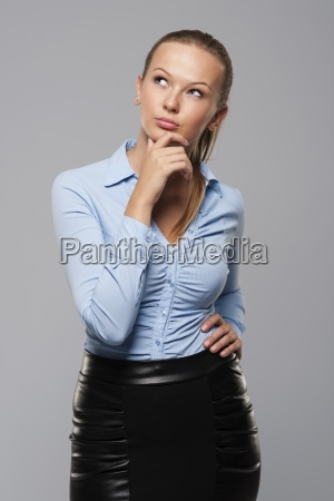 pensive and confusion young businesswoman looking