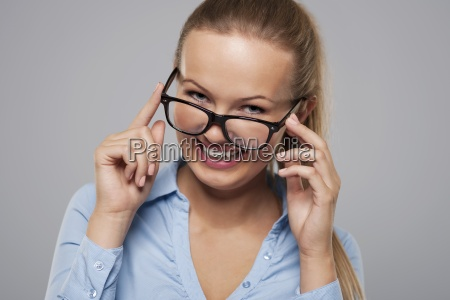 cute young businesswoman wearing fashion glasses